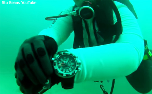 citizen_BN2029-01E worn on wrist seen under water scuba diver green water professional depth meter, eco-zilla